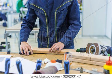 Professional Man Carpenter Working With Wooden Details On Rough Workbench At Workshop. Design, Carpe