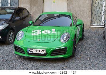 Kharkov, Ukraine - September 24, 2019: Porsche 911 Carrera 4s In Green Color With White Stickers Of