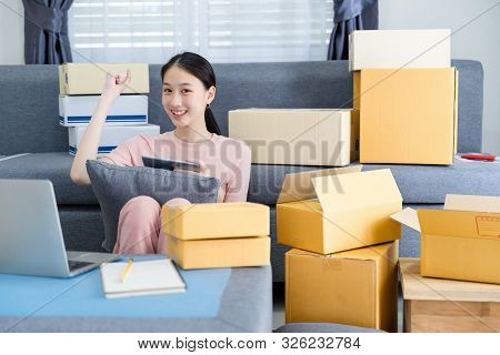 Excited Asian Young Entrepreneur Waving Fists, Got Good New Orders On Digital Tablet While Working A