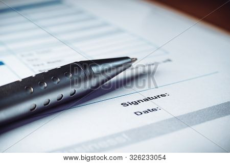 Close-up Of Silver Pen Are Signing The Contract Policy Agreement Papers. Legal Contract Signing.