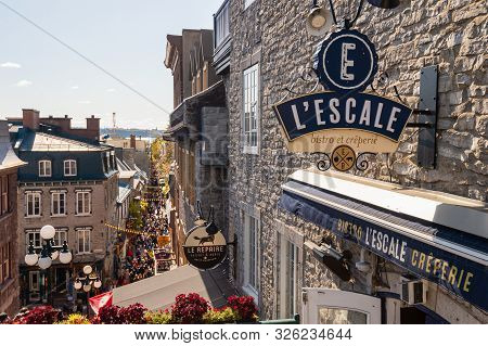 Quebec City, Canada - 5 October 2019: Escale Restaurant And Petit Champlain Street Crowded With Tour