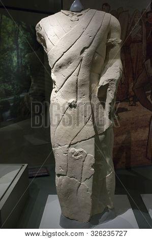 Jaen, Spain - December 29th, 2017: Male With Manipule, Iberian Ancestor Sculpture From Site Cerrillo