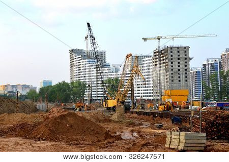Huge Construction Site With A Lot Of Construction Equipment, Houses Under Construction, Tower Cranes