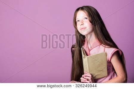 Thirst of knowledge. Reading literature as hobby. Fiction and nonfiction. Adorable bookworm. Cute small child reading book on violet background. Little girl learn reading. Home schooling concept poster