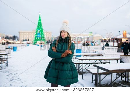 Beautiful Woman In The Winter On The Street With New Year Decorations. Christmas Fair.