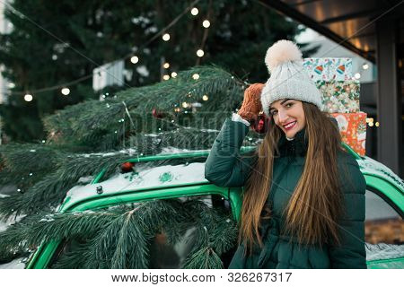 Beautiful Woman With New Year Decorations And Balls On Background Of Green Retro Car.christmas And N