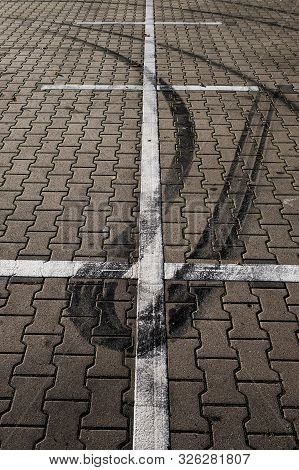 Car Traces On Pavement. Auto Wheel Drift