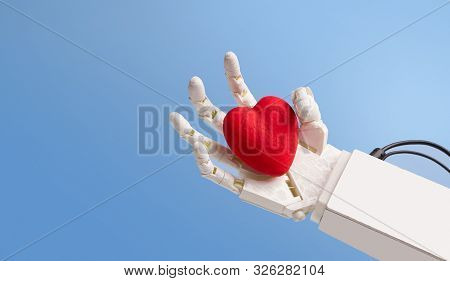 Red Heart In Robot Hand, Blue Panorama Background With Empty Space
