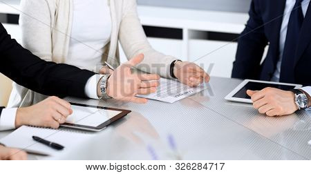Business People Discussing Contract Working Together At Meeting At The Glass Desk In Modern Office.