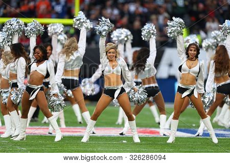 LONDON, ENGLAND - OCTOBER 06 2019: Cheerleaders perform during the NFL game between Chicago Bears and Oakland Raiders at Tottenham Stadium in London, United Kingdom.