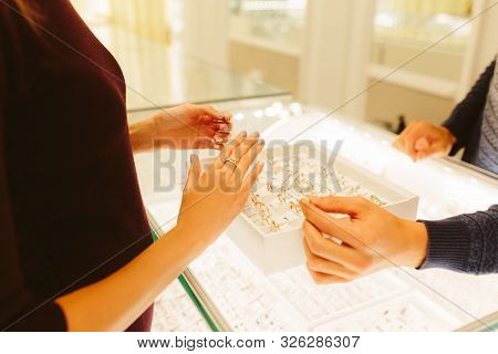 Jewelry Store Shop Indoors - Small Business. Gold And Diamonds For Sale. Female And Male Hands. Sell