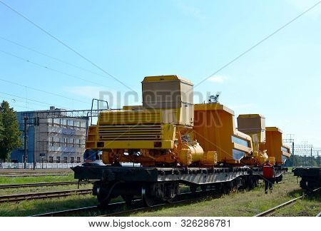 Logistics Transportation Heavy Mining Dump Truck By Rail. Yellow Mining Truck Disassembled Into Part