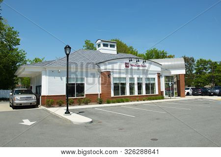Millis, Ma, Usa - May 10, 2018: Historic Needham Bank On Main Street At The Town Center Of Millis In