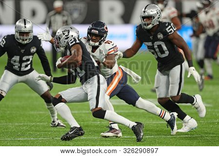 LONDON, ENGLAND - OCTOBER 06 2019: Cornerback Gareon Conley of The Oakland Raiders is tackled by Wide Receiver Anthony Miller of The Chicago Bears during the NFL game between Chicago Bears and Oakland