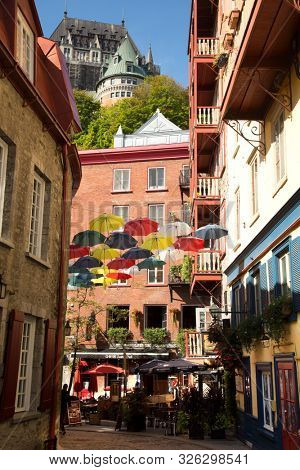 QUEBEC-CANADA, SEPT 12, 2019:  Umbrellas over the old Quebec city, the oldest city in Canada with the Chateau Frontenac in the background