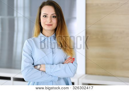 Business Woman Headshot At Workplace In Modern Office. Unknown Businesswoman Standing Straight With