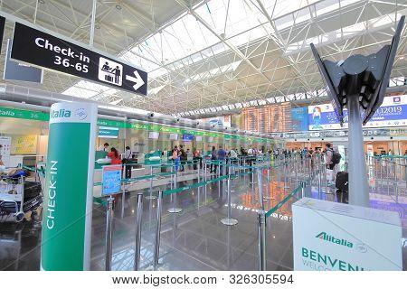 Rome Italy - June 19, 2019: Unidentified People Check In At Alitalia Check In Counter Leonardo Da Vi