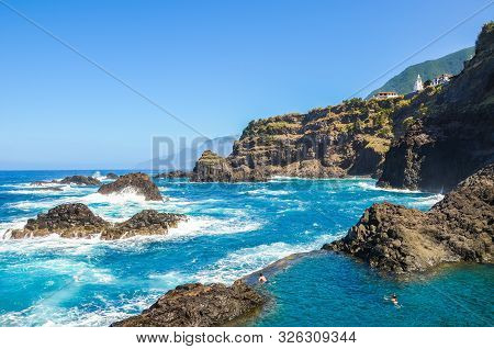 Seixal, Madeira, Portugal - Sep 13, 2019: People Swimming In Natural Swimming Pools In The Atlantic