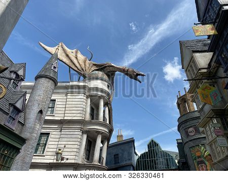 Orlando,fl/usa-10/6/19: The Dragon On Top Of Gringotts Bank In The Diagon Alley Portion Of The Wizar