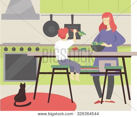 Mom And Son Cooking Together In The Kitchen