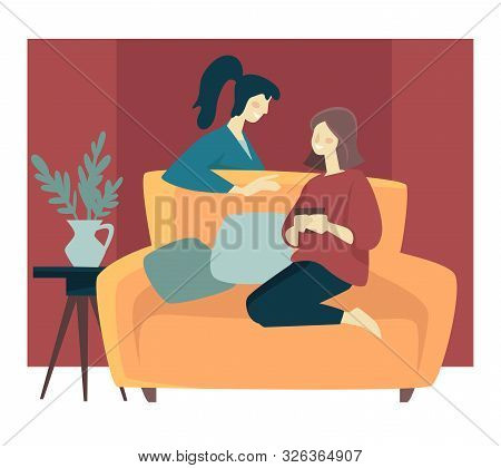 Girlfriends Spending Cozy Winter Evening And Sitting On Sofa