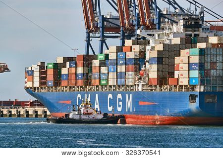 ROTTERDAM, THE NETHERLANDS - SEPTEMBER 20, 2019: Huge container ship in port being loaded in the Euromax container terminal in the Port of Rotterdam