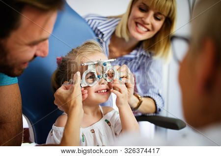 Ophthalmologist, Optometrist Checking Child Vision Looking For Problems And Caring For Eye