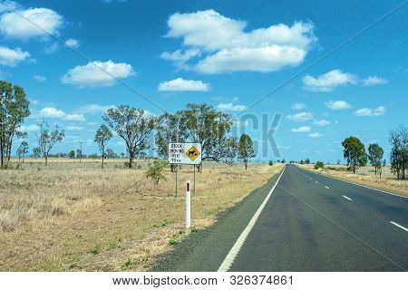A Sign Warning Of Stock Droving On An Australian Inland Highway