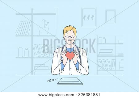 Heart, Cardiology, Health, Medicine Concept. Young Happy Doctor Cardiologist, Holding A Model Of The