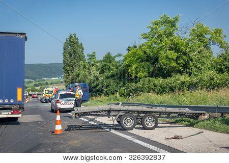 Tatabanya, Hungary. June 25, 2019: Car Crash Accident On Highway. Damaged Overturned Car After Colli