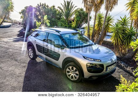 Candelaria Tenerife Spain 05.09.2019 Rental Car Citroen C4 Is Parked On A Tropical Parking Lot With