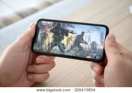 Anapa, Russia - October 2, 2019: Man Hand Holding Iphone 11 With Game Call Of Duty Mobile In The Scr
