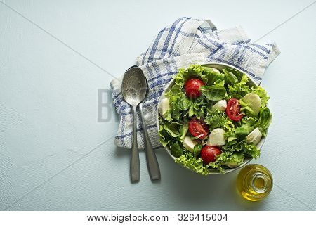 Healthy Green Salad With Tomato And Mozzarella Cheese. Home Made Food. Concept For A Tasty And Healt