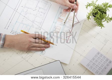 Architects Working On Blueprint, Real Estate Project. Architect Workplace. Construction Concept. Eng