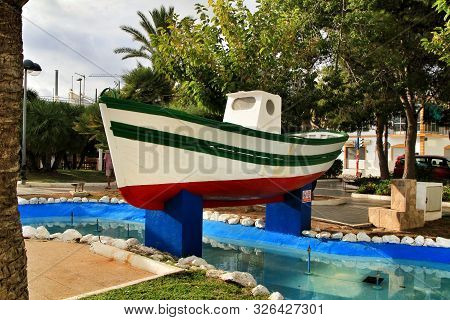 Colorful fishing boat in the main square of Isla Plana village in Cartagena province, Murcia, Spain poster