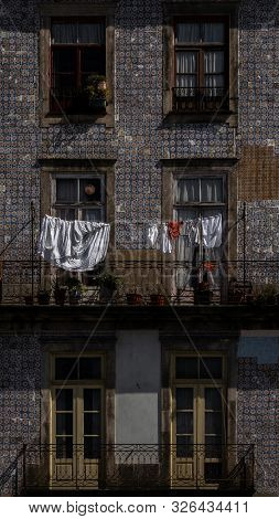Porto, Portugal - 22/09/2019: Six Windows On A Tipical House In Porto, The Two Middle Windows Have S