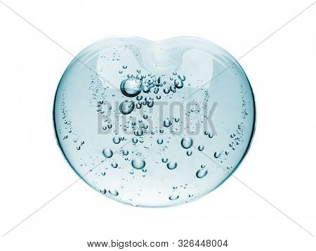 Squeezed cosmetic clear cream gel texture Iisolated on white background. Close up photo of transparent drop of skin care product. High Quality transparent gel with bubbles closeup on white background