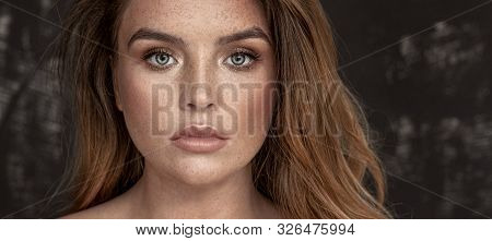 Beauty Girl With Freckles.