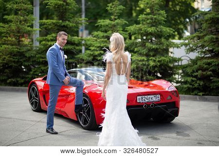 Novosibirsk, Russia - 06.15.2019: Beautiful Young Couple Of Bride And Groom During A Wedding Are Pho