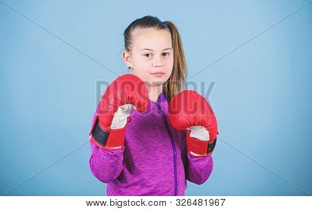Girl Cute Boxer On Blue Background. With Great Power Comes Great Responsibility. Contrary To Stereot