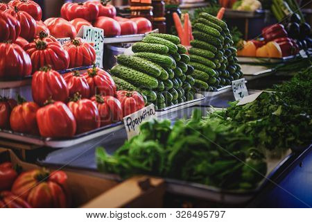 Appetising Variety Of Vegetables On The Counter, Fresh Tomatoes, Cucumber, Salad, Peppers, Carrots.