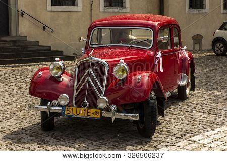 Tyniec, Krakow, Poland, August 3, 2019: Old, Antique Red Car Used To Transport Newlyweds At The Wedd