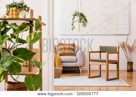 The Stylish Boho Interior Of Living Room In Nice Apartment With Gray Sofa, Honey Yellow Plaid And Pi