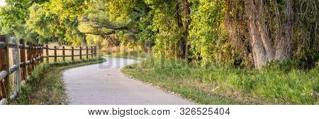 bike trail panorama in early fall -  multi use Poudre River Trail in northern Colorado
