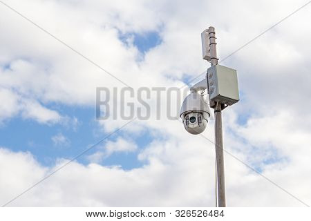 Security Camera On A Construction Site. Video Surveillance Of The Perimeter.