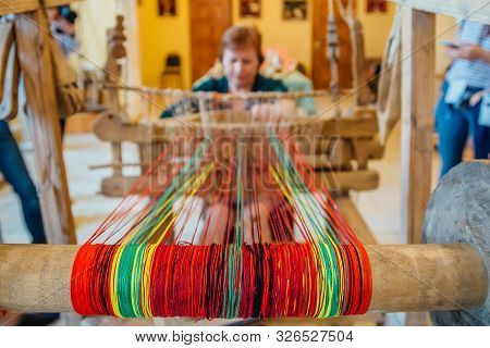 Woman Works With Traditional Hand Weaving Loom