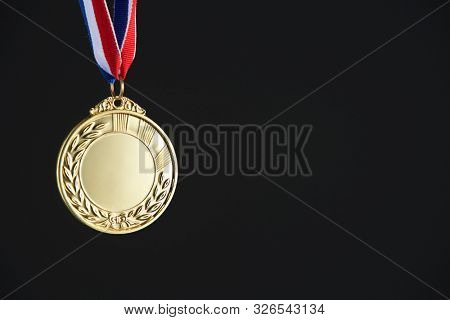 blank gold medal on the black background
