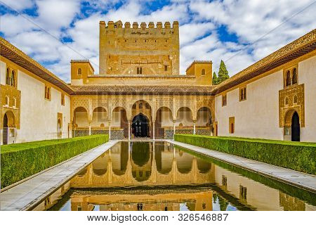 Granada, Spain - September 22, 2019: Columns And Tower Of The Alhambra In A Sunny Day. It´s A Nasrid