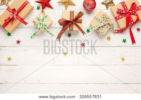 Christmas background with gift boxes and Christmas decorations and  on white wooden background. Winter festive concept. Flat lay, copy space.