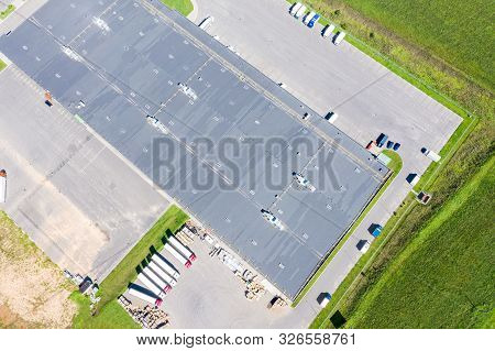 Aerial Top View Of Distribution Warehouse In City Industrial Area